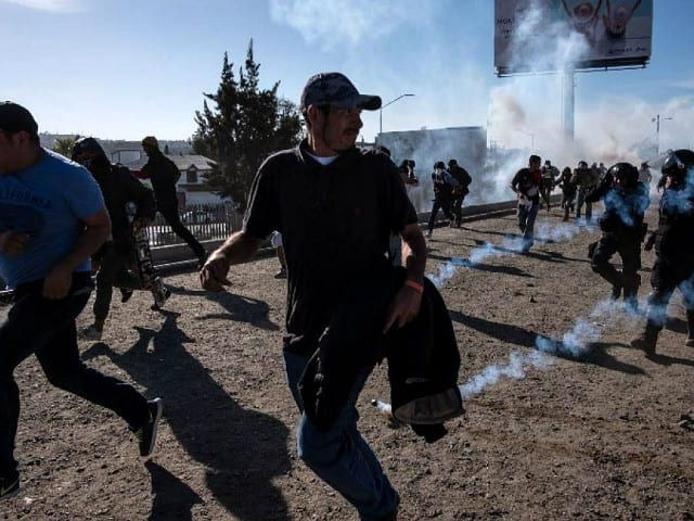Progressives Vent as Tear Gas Is Used to Stop Migrants at the Border